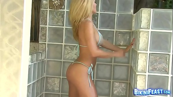 Big titted babe showers and shows all