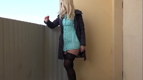 A blonde without panties smokes on a public balcony and masturbates with a dildo. Fetish and juicy PAWG under a short dress outdoor. Thumb