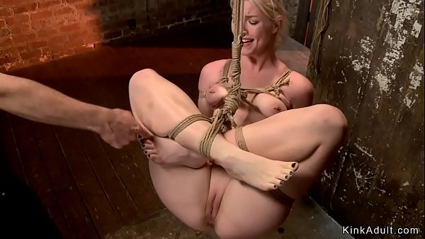 Blonde slut is anal toyed in bondage
