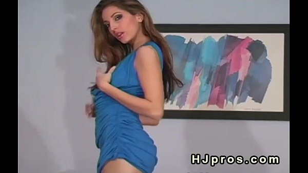 Brunette in blue dress and silk pantyhose posing