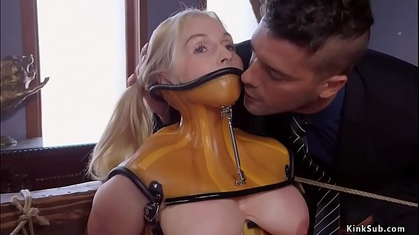 Slave in plastic corset gets anal