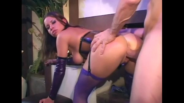 Sex in a latex corset and purple fishnet stockings