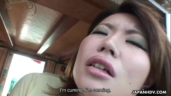 Asian babe on a fishing boat tries out the sex toy