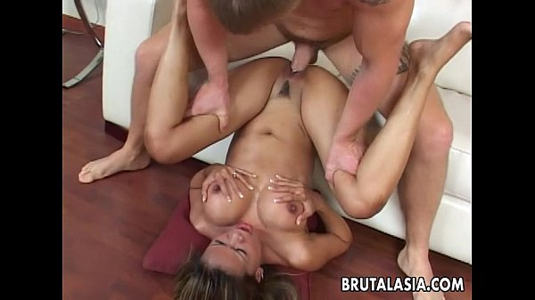 Busty Asian slut groans while her booty is pounded hard