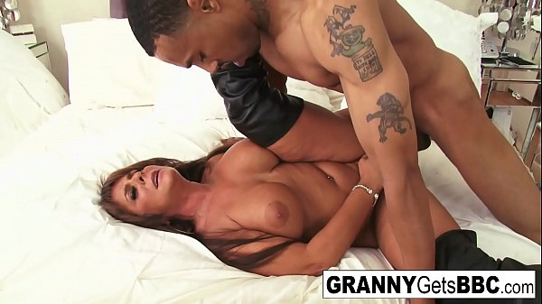Busty brunette mature takes the black cock in h...