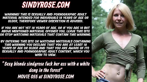 Sexy blonde Sindy Rose fuck her ass with a white dong in the forest
