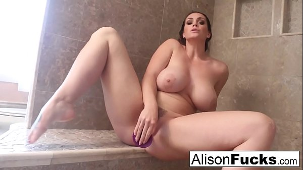 Alison rubs herself to completion in a giant steamy shower