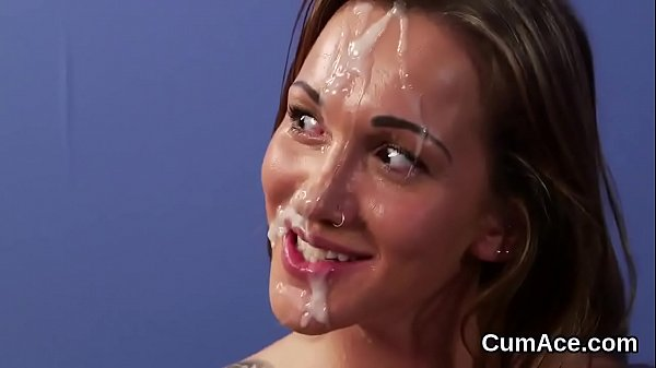 Flirty looker gets cum load on her face swallowing all the juice