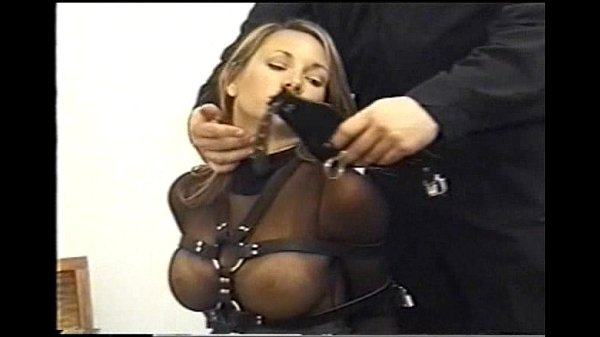 Very cute Andrea Neal is bound, gagged and blindfolded, wearing a sexy outfit Thumb