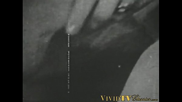 Black and white vintage video of lady sucking her lover
