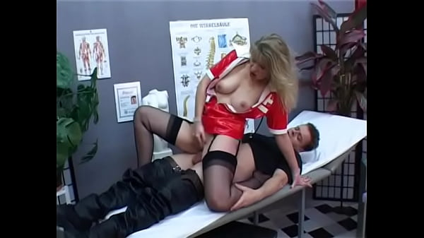 Sexy nurse in red latex uniform gives blowjob to patient in hospital bed