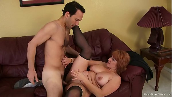 Busty mature redhead screams as she gets fucked hard