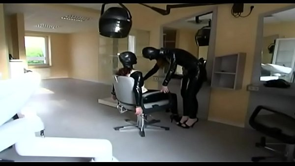 Mistress and slave in latex go to the hairdresser