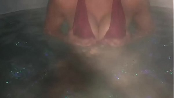Hot young lady in hot tub