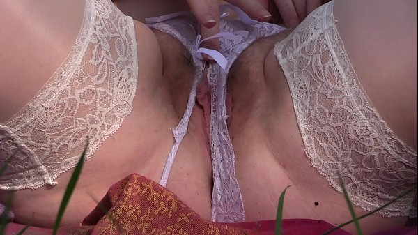 Mature hairy pussy closeup outdoors. Milf in wh...