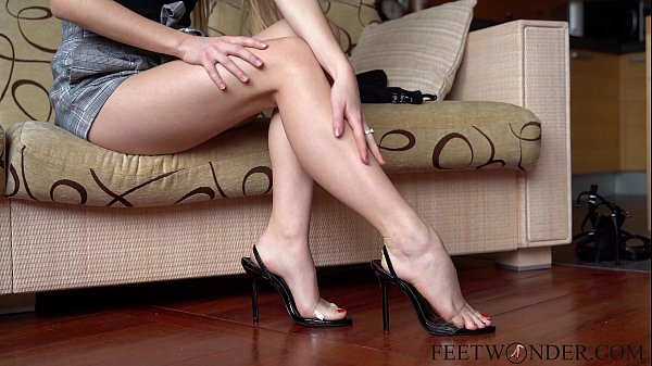 Sexy feet on high heels dangling