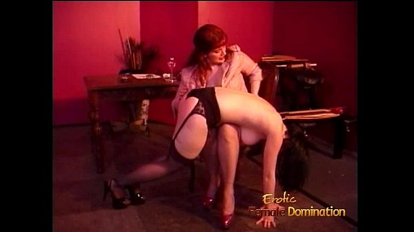 Busty raven-haired harlot enjoys letting a redhead slag spank her hard