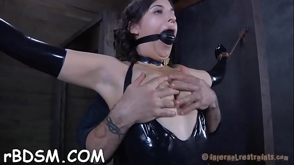 Bounded slave beauty is getting a lusty slit pu...