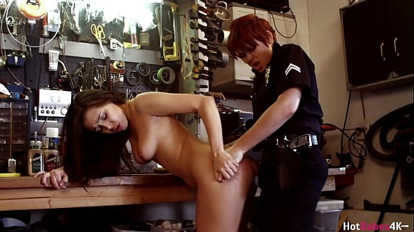 Officer Lily Cade Pleases Jenna Sativa In Garage!
