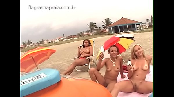 Ice cream seller is surprised by group of naked girls on the beach Thumb