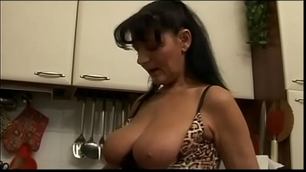 Big tits of an ugly milf in his mouth!