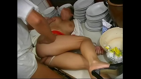 Shameless workers fucking in the kitchen of a restaurant