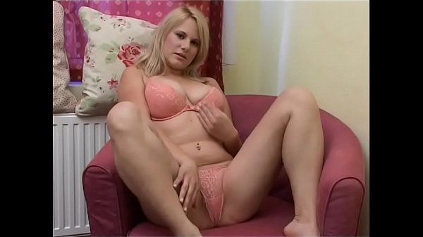 Paula Jay alone in her bedroom has fun with a big pink toy