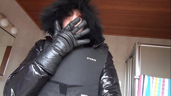 Enclosed by a bodyprotector and covered by a female silicone mask Thumb