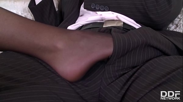 Foot fetish porn with busty British babe Emma Leigh in thigh high pantyhose