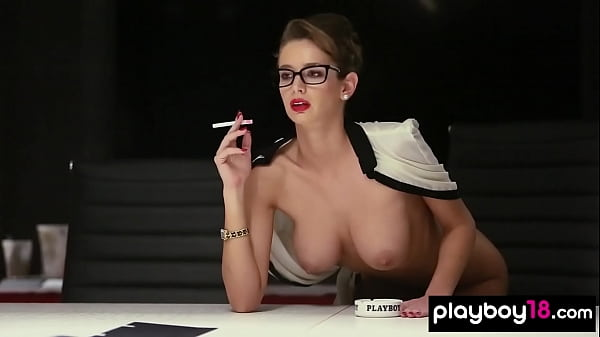 Hot secretary Emily Agnes copying her massive tits in the office Thumb