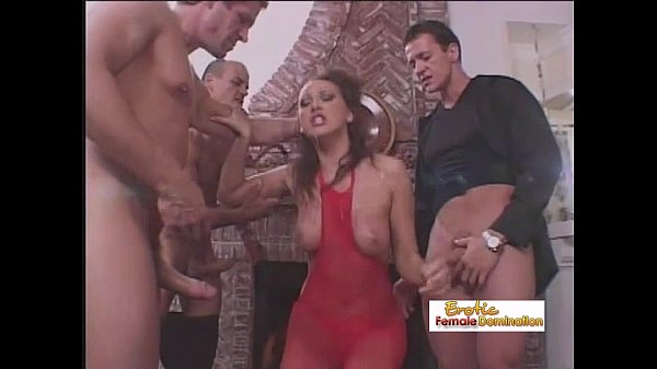 Gorgeous brunette gets fucked by three cocks at...