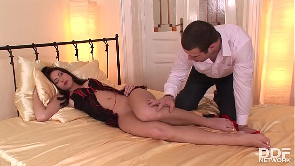 Stracy strokes a stiff dick and gives a footjob with her pantyhose feet