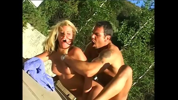 Nasty blonde whore Summer Storm with big jugs is fond of being nailed by her sunburnt friend at the backyard