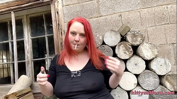 Big Titty Smoke by the Log Pile starring Kitty Milford
