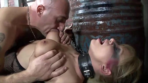 Chained up fetish girl gives a blow job before to be buggered