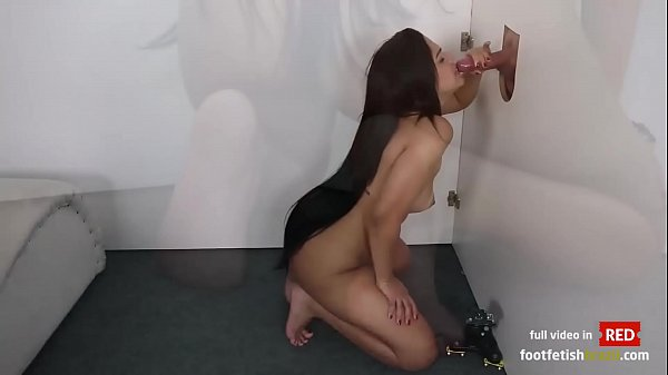 Yara Rocha sucking a big dick and gives and footjob in the gloryhole
