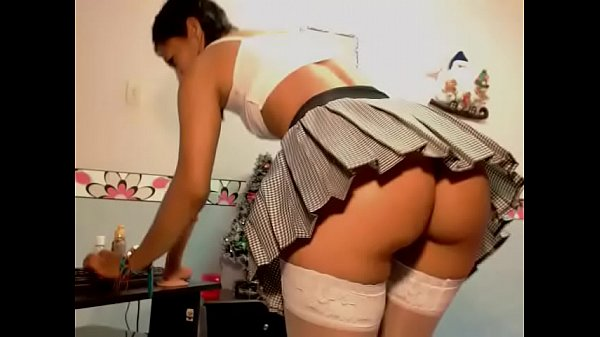 Young girl in mini skirt masturbating with thick dildo