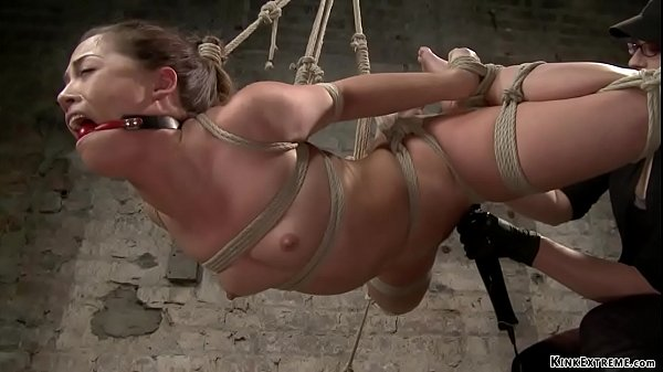 Lesbian slave is whipped on hogtie