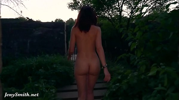 Jeny Smith is walking naked through an abandoned factory.