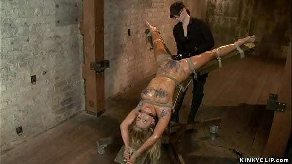 Waxed and bound lesbian on hogtie