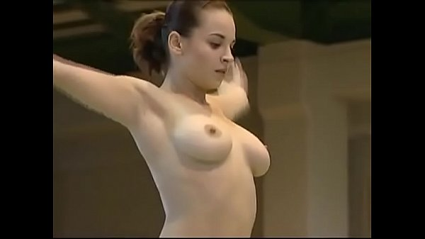 Hot gymnast gets topless for her routine