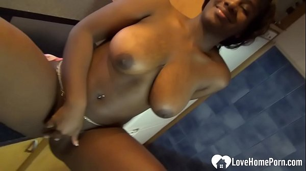 Ebony chick shows her amazing big boobs