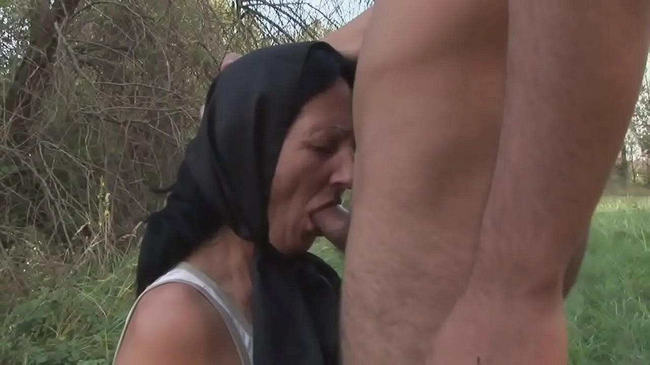 Old woman without dentures sucks a young man's cock in the woods
