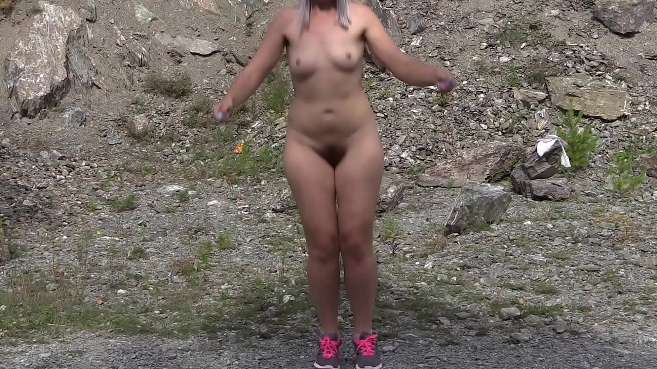 Naked blonde with a big ass and hairy pussy is jumping rope outdoors. Nudism, and amateur fetish.