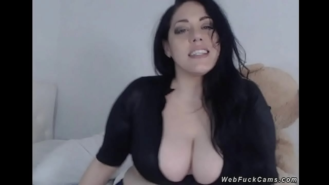 Babe flashing huge natural tits on cam