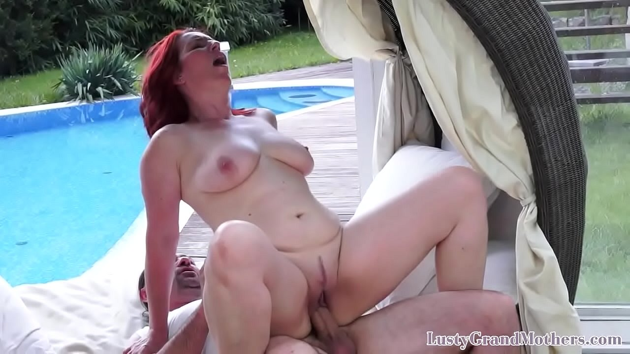 Redheaded granny seduced by younger man