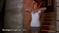 Chained babe gangbang f...