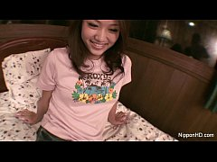 Asian girl plays with...