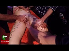 A group of people massage this young and tattoed girl at the same time in public