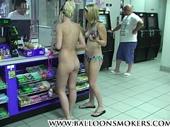 Blonde teen walks into market nude